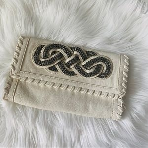 White clutch and bag